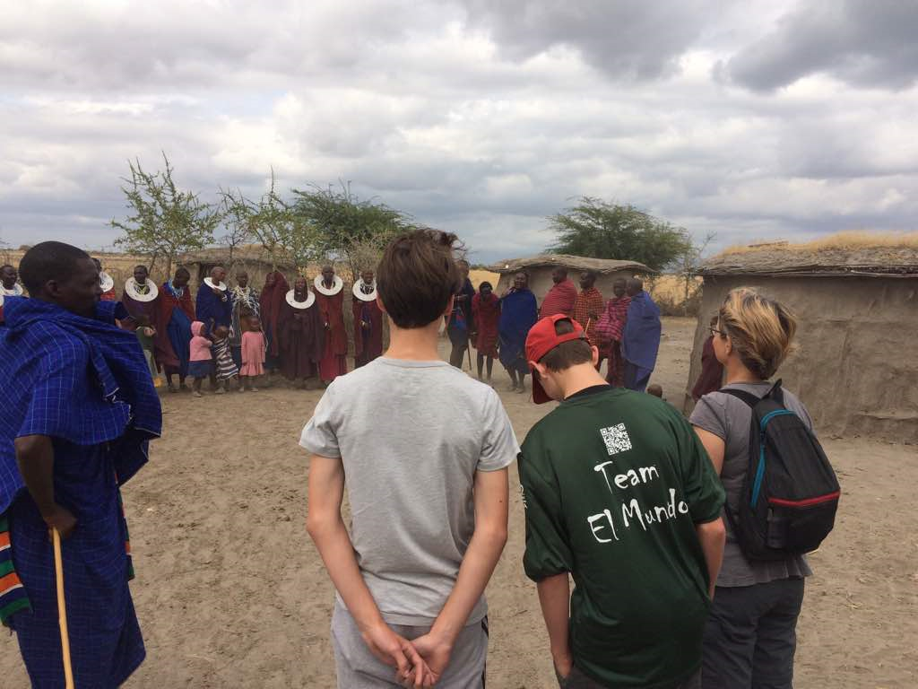 Tourist with Maasai in the Boma.
